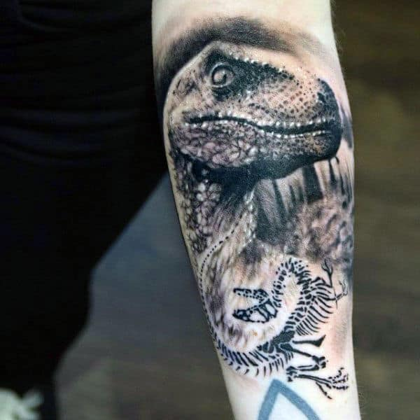 Amazing Dinosaur Tattoo With Tiny Skeletal Bones Tattoo Male Forearm