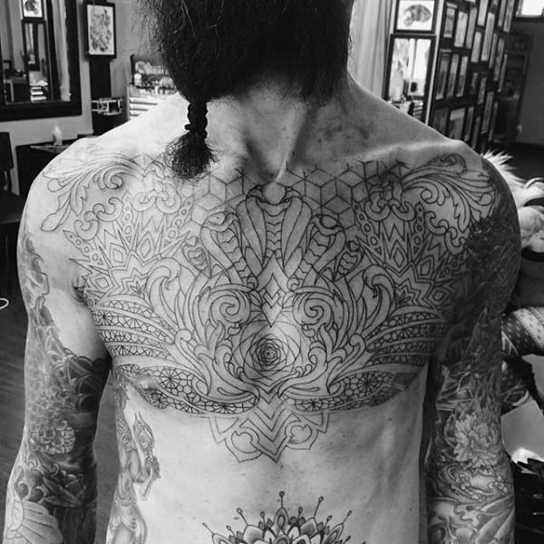 Amazing Filigree Male Chest Tattoo With Black Ink Outline Design