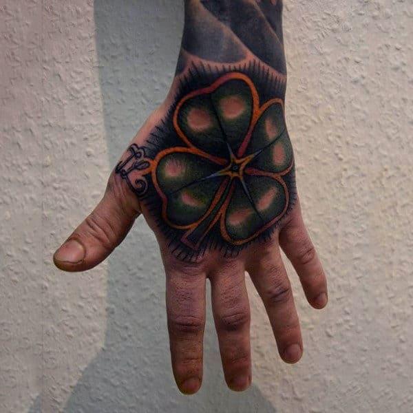Amazing Four Leaf Clover Hand Tattoo On Man