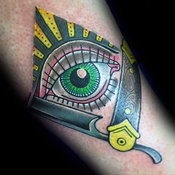 Amazing Green Yellow Ete And Straight Razor Tattoo