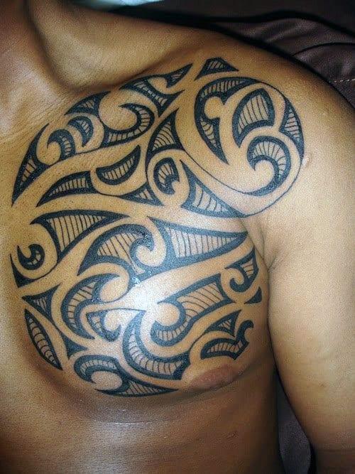 Amazing Male Chest Tribal Tattoo Designs