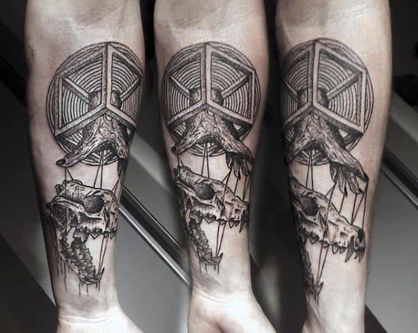 Amazing Male Wolf Skull Tattoo Design On Inner Forearm