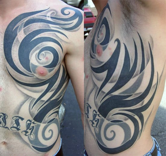Amazing Mens Shaded And Solid Black Ink Tribal Ribs Tattoos