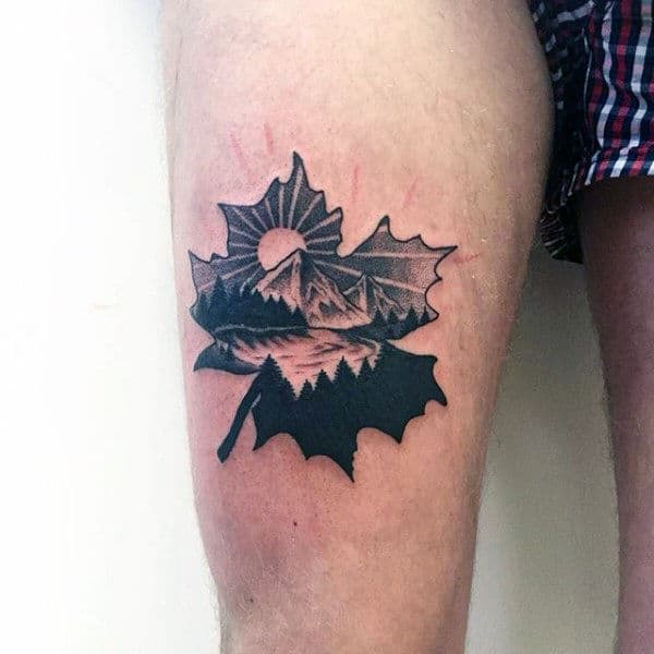 Amazing Small Maple Leaf Landscape Of Nature Thigh Tattoo On Male