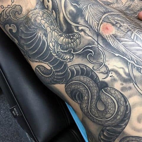 Amazing Spitting Cobra Mens Ribs Tattoos