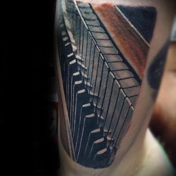 Amazing Tattoo Of 3d Piano Keys On Gentleman