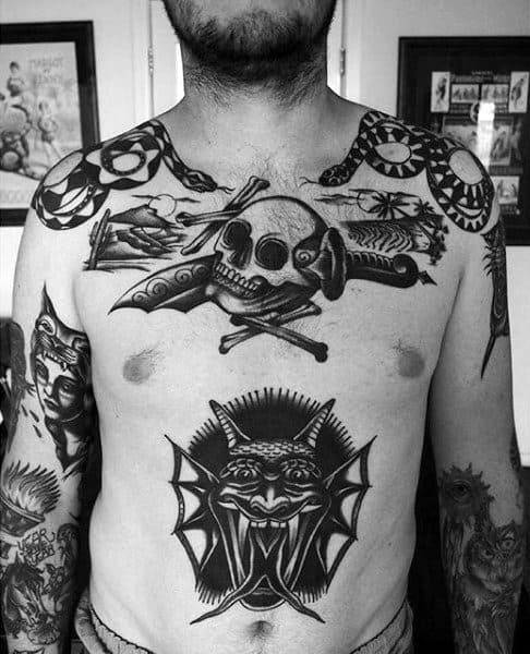 Amazing Traditional Skull With Crossbones And Dagger Tattoo On Gentlemans Chest