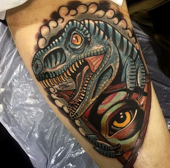 Amber Eyed Dinosaur And An Eye Tattoo Male Forearms