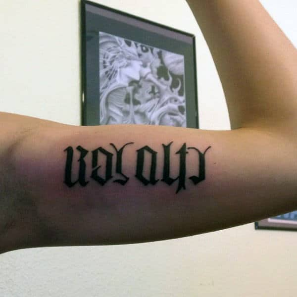 Ambigram Tattoo Ideas For Men On Bicep