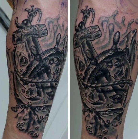 Anchor Breaking Through Ship Wheel Tattoo For Men On Arm