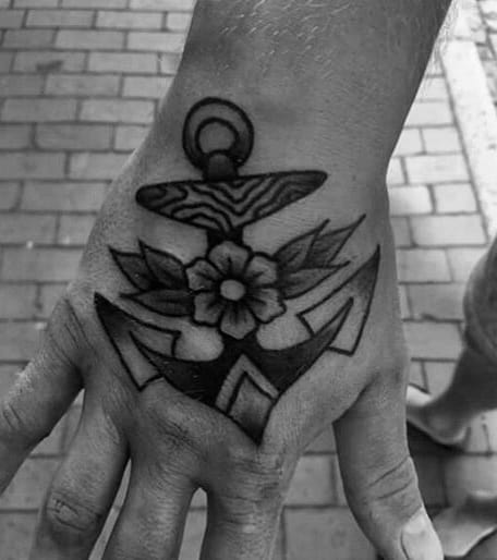 Anchor With Flower Cool Traditional Hand Tattoo On Man