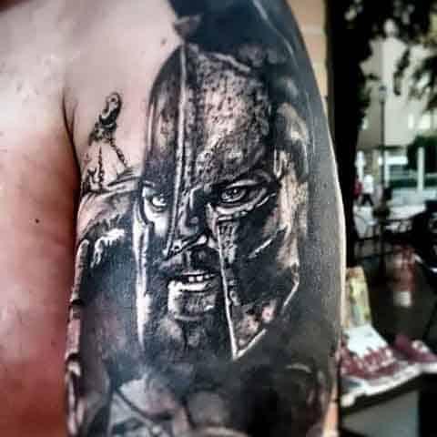 Ancient Solider Men's Spartan Tattoo Designs On Arm