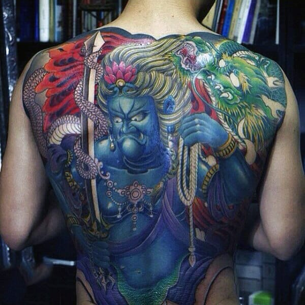 Ancient Tribal Chief With Blue Body And Arrows Tattoo Guys Full Back