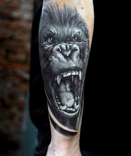 Angry Mens Gorilla Tattoos On Back Of Forearm In Black Ink