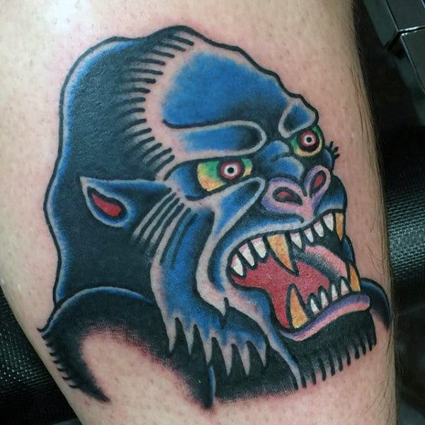 Angry Traditional Gorilla Tattoo With Colorful Style And Green Eyes