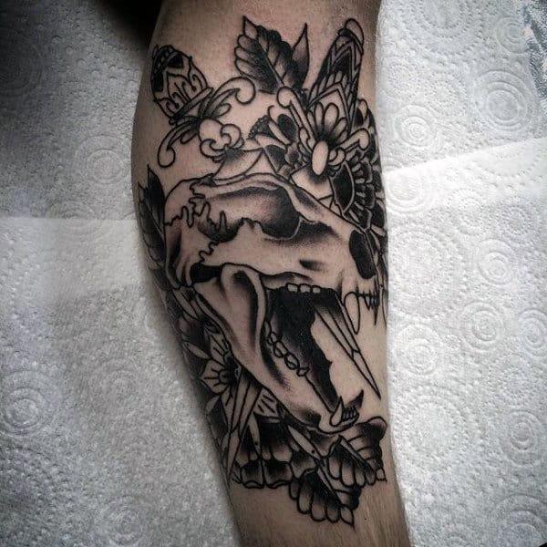 Animal Skull With Dagger Mens Traditional Leg Tattoos