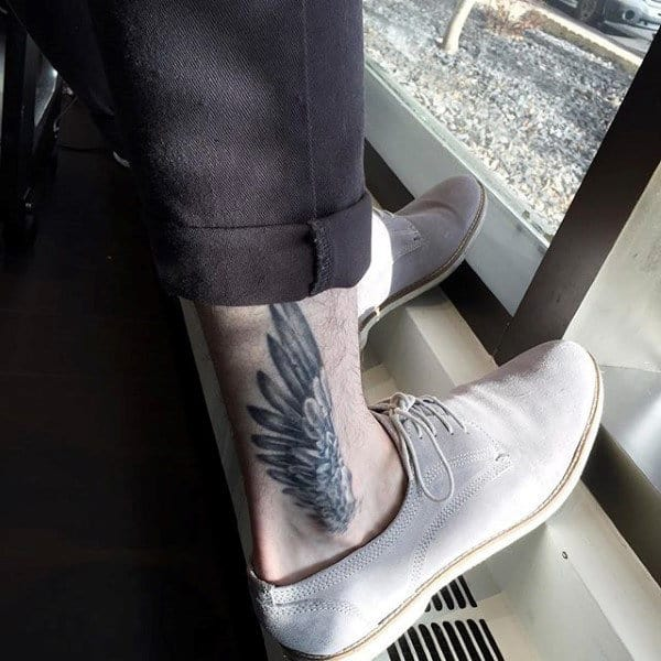 Ankle Hermes Wing Tattoo On Gentleman