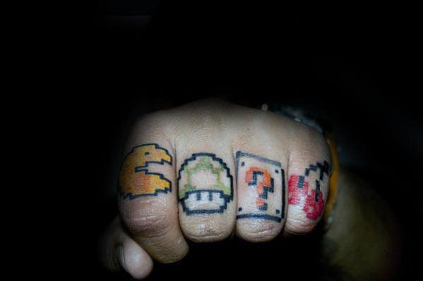 Arcade Game Themed Guys Finger Tattoo With Pacman Design