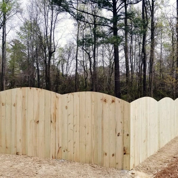 Arched Unstained Wooden Fence Backyard Design