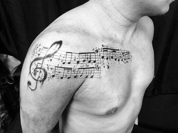 Arm And Chest Incredible Music Staff Tattoos For Men