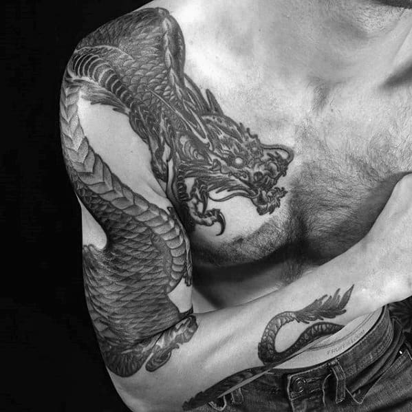 Arm And Shoulder Tattoo Of Dragon On Male
