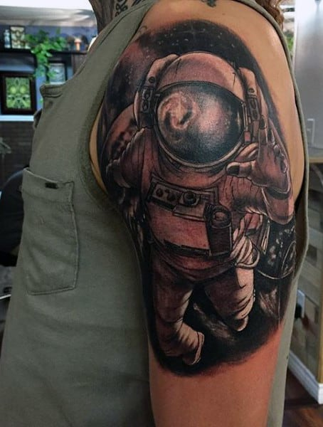 Arm Cosmic Tattoo On Man With Astronaut