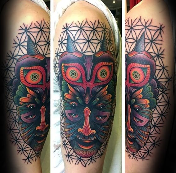 Arm Geometric Majoras Mask Mens Tattoo Ideas