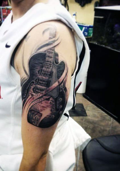 Arm Gibson Guitar Tattoo On Men