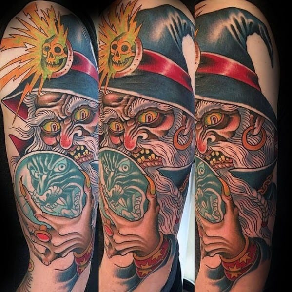 Arm Male Witch Crystal Ball Tattoo Design Inspiration