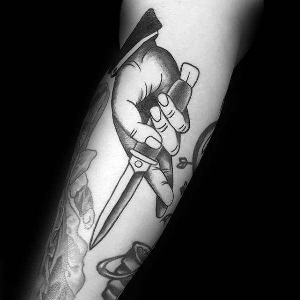 Arm Mens Hand Holding Switchblade Tattoo Design Inspiration