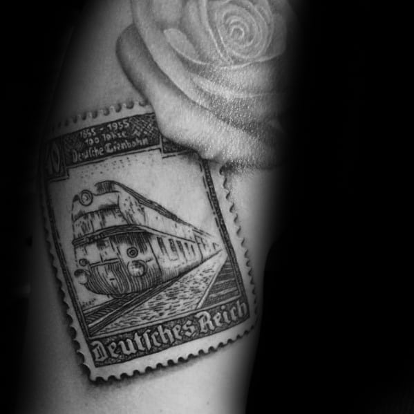 Arm Train Postage Stamp Tattoo Designs For Guys