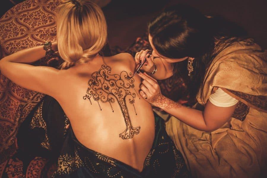 Artist Applies Henna Tattoo Tree Of Life Back