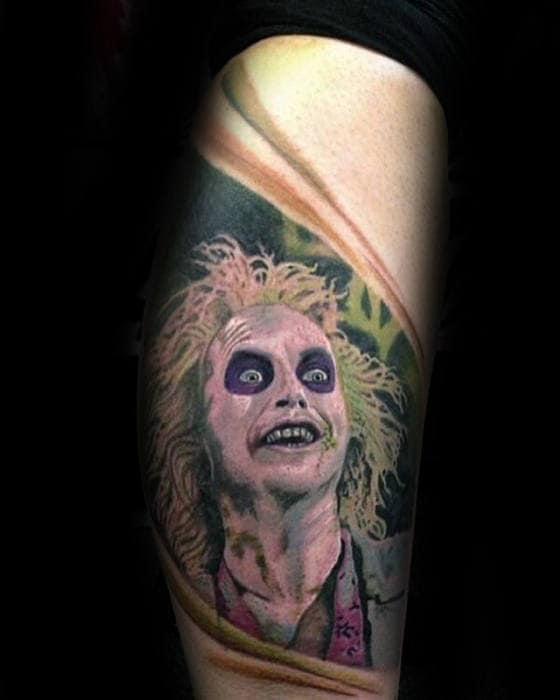 Artistic Male Beetlejuice Tattoo On Arm