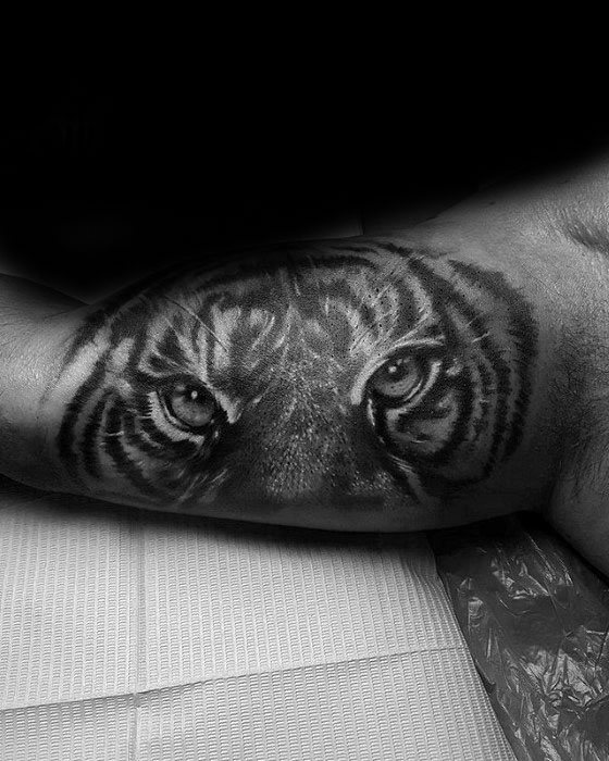 Artistic Male Inner Arm Bicep Tiger Eyes Tattoo Ideas