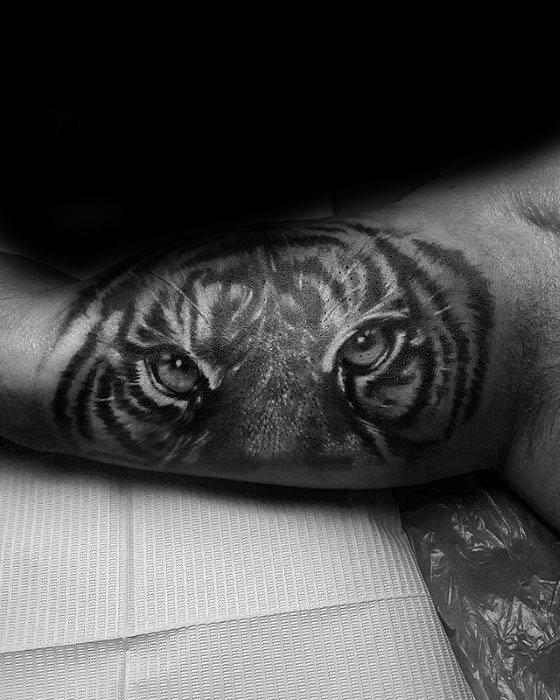Artistic Male Inner Arm Bicep Tiger Eyes Tattoo Ideas