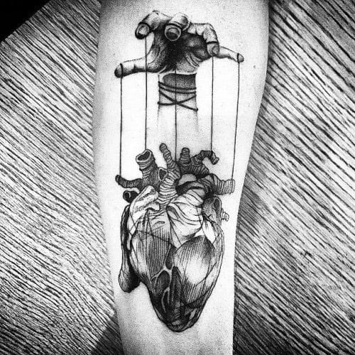 Artistic Male Puppet Tattoo Ideas