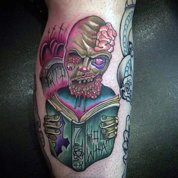 Artistic Zombie Reading Book With Tombstones Male Tattoo On Leg