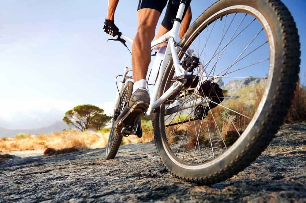 athlete man riding mountain bike outdoor