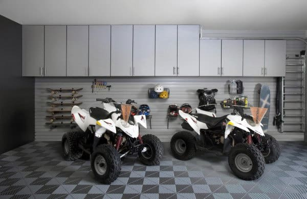 Atvs In Custom Garage With Organized Storage Design