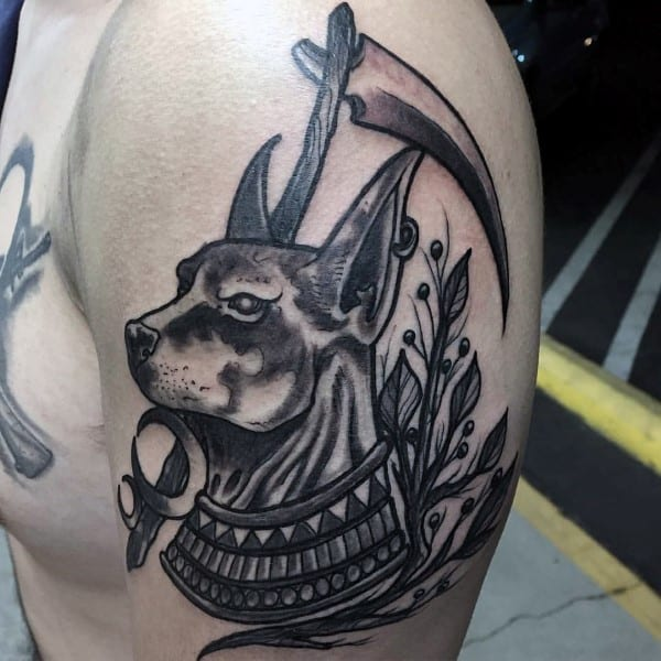 Awesome Anubis Upper Arm Male Tattoo With Shaded Black Ink