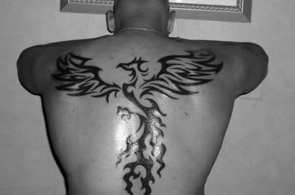 Awesome Back And Spine Male Flaming Phoenix Tribal Tattoos
