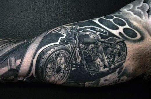 Awesome Biker Tattoo On Mans Arm With Shaded Ink Design
