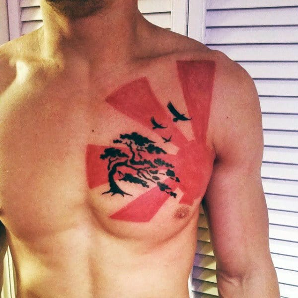 Awesome Black And Red Ink Guys Chest Tattoo Of Rising Sun With Bonsai Tree And Flying Birds