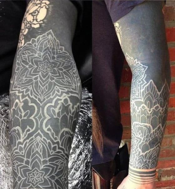 Awesome Blackwork White Ink Sleeve Tattoo On Man