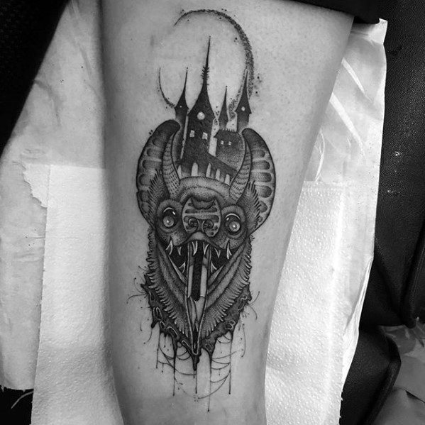 Awesome Castl With Bat And Pencil Thigh Tattoos For Men