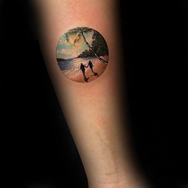 Awesome Circle Male Small Beach Themed Tattoo On Inner Forearm