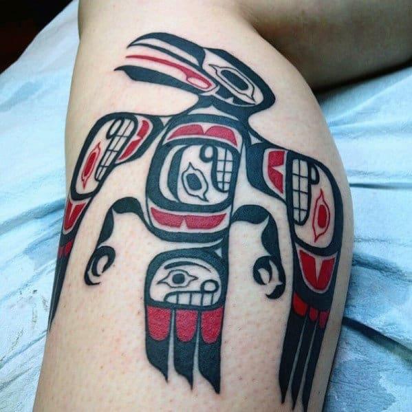 Awesome Haida Tribal Bird Red And Black Ink Leg Tattoo