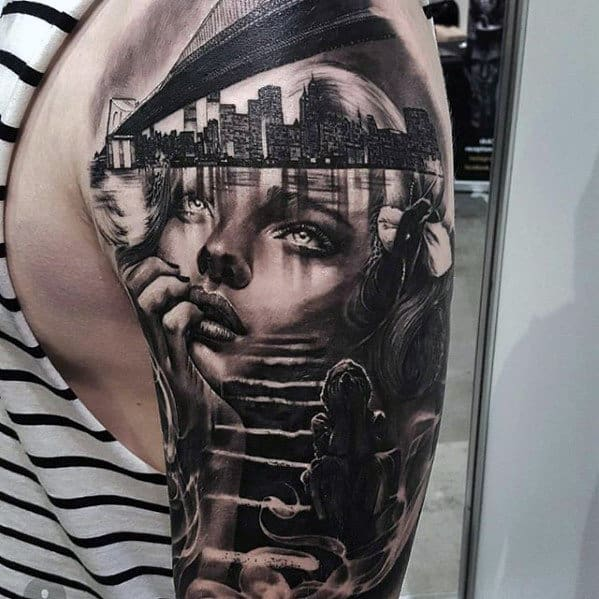 Awesome half sleeve mens female portrait with city skyline tattoo