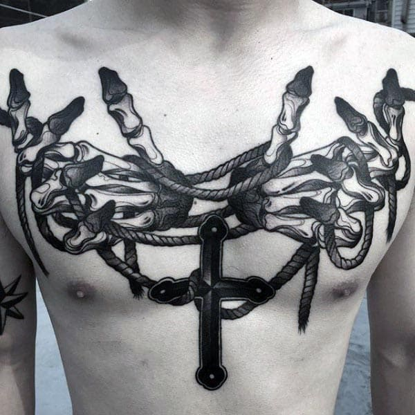Awesome Hand Bones Holding Rope And Cross Mens Chest Tatoo