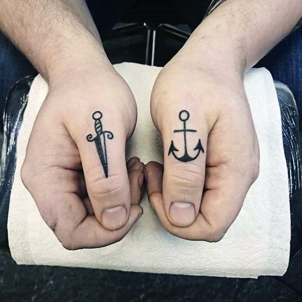 Awesome Knuckle Tattoos For Males Sword And Anchor